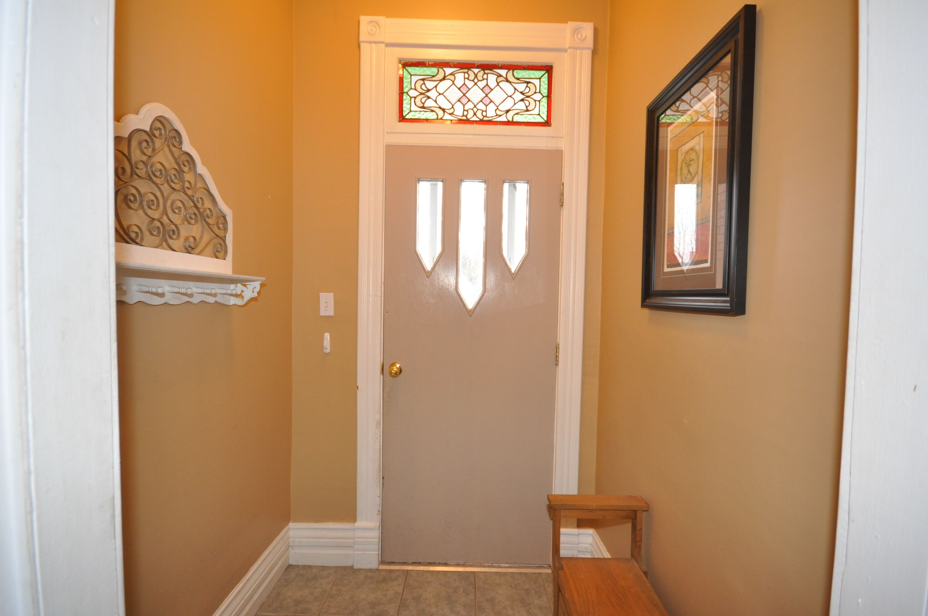 Ceramic foyer & stained glass window