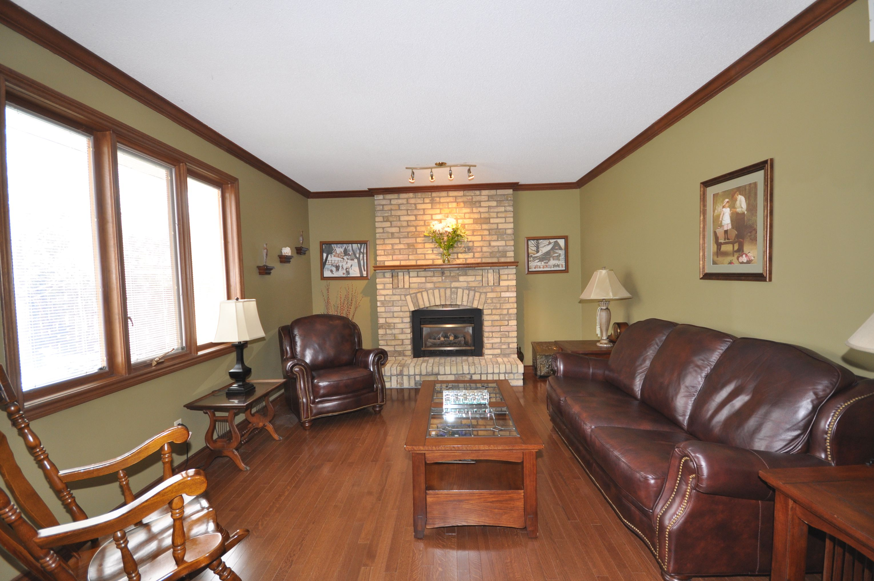 Sunken Family Room with floor to ceiling brick gas fireplace