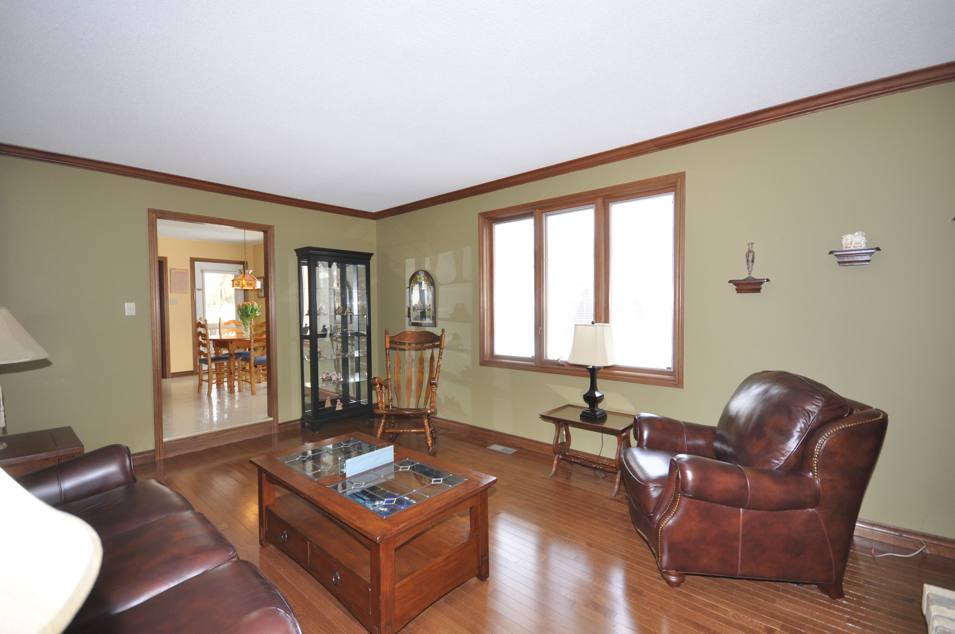 Gleaming oak hardwood flooring, trim & crown moulding in the Family Room