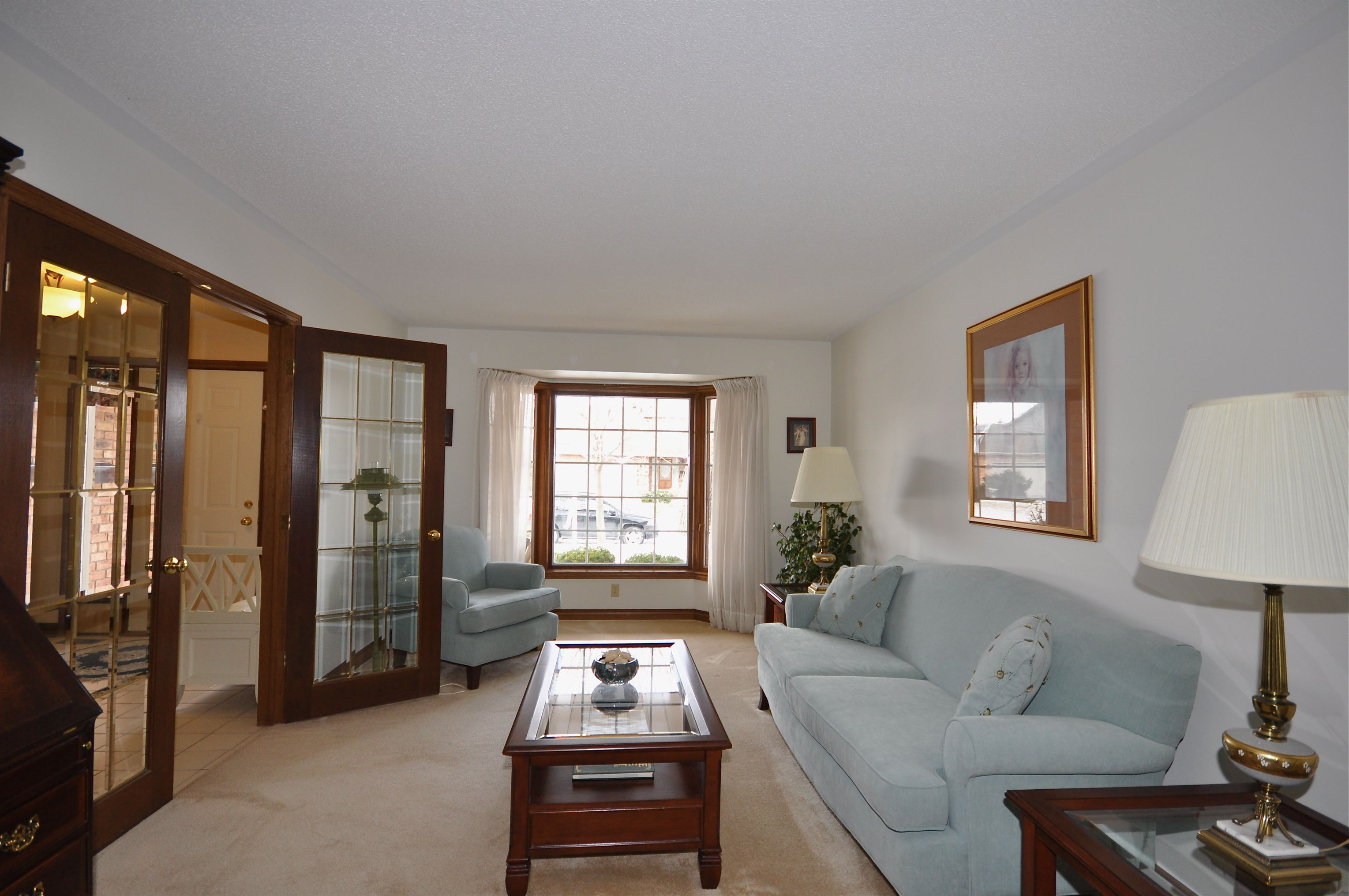 French doors to Living Room with large sunny bay window