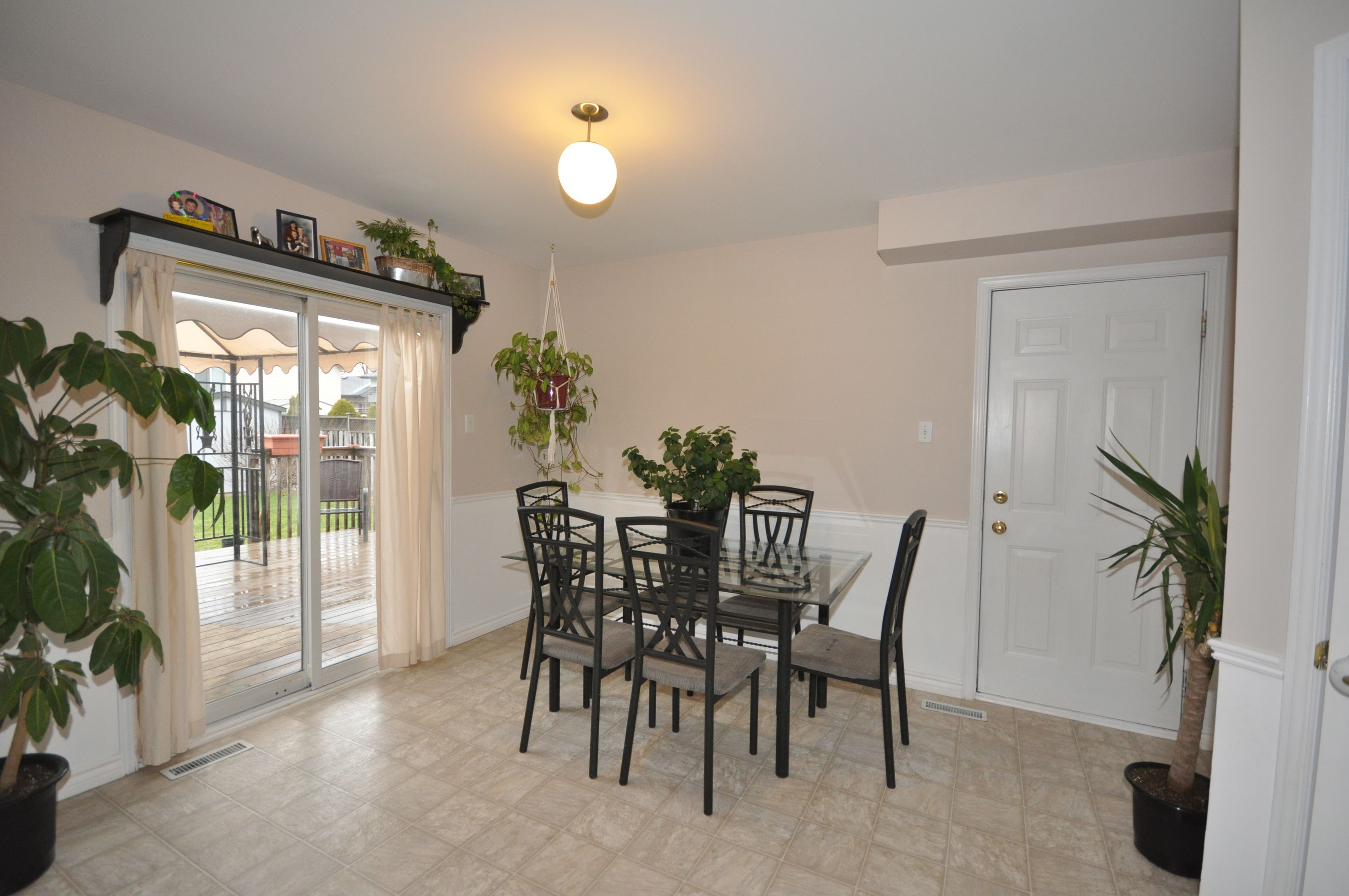 Spacious eating area with patio doors to sundeck