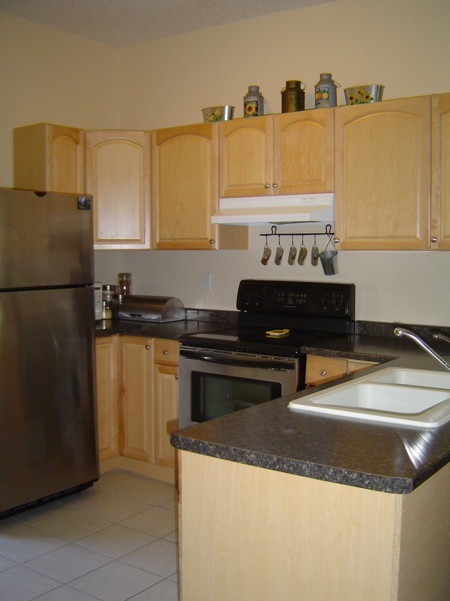 Newer kitchen located at the back of the house