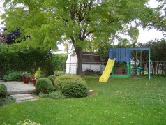 Professionally landscaped yard complete with play gym for the little ones