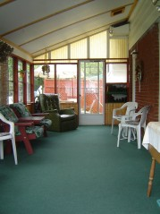 Relax with your morning coffee in this large 3 season sunroom
