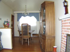 Cozy dining room off of living room also has hardwood flooring