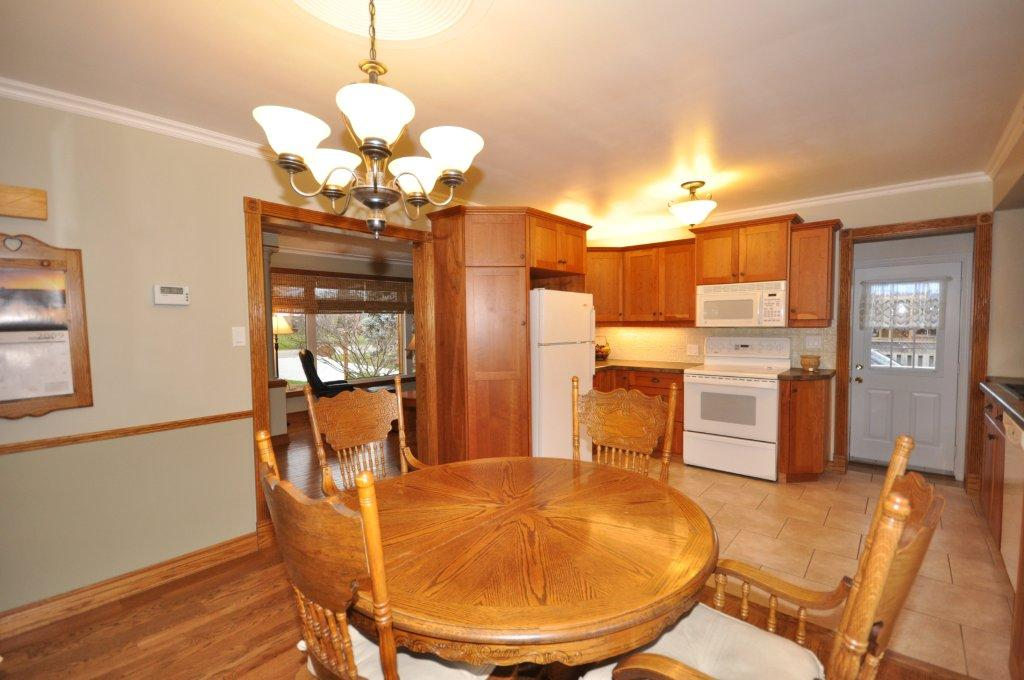 Kitchen opens to the dining area which has newer patio doors to the Sundeck