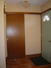 Front foyer has pocket door to the kitchen & ceramic flooring.