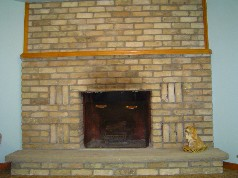 Family room with a wonderful corner floor to ceiling brick wood burning fireplace with a heatilator.