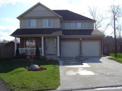 2 storey home with attractive covered front porch, concrete drive & walkway!
