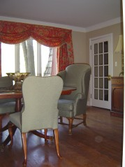Lots of sunny windows & french doors leading to the living area from the dining room