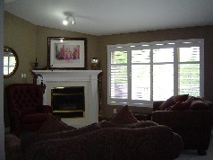 Corner gas fireplace, and sunny windows in main floor family room