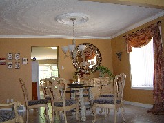 Pillared dining room with decorative ceiling