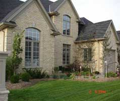 Extensive landscaping both front and back accentuates large windows