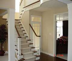 Open side staircase to second level off foyer