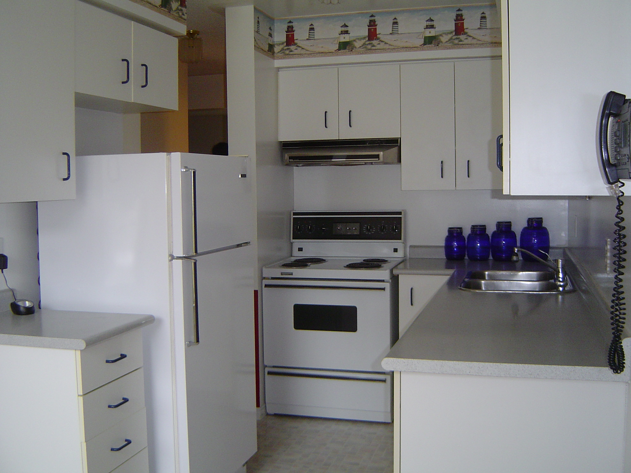 Tons of cupboard and counter space in the eat in kitchen
